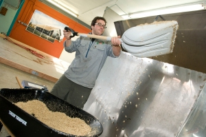 Loading the germinated malt into the drier.