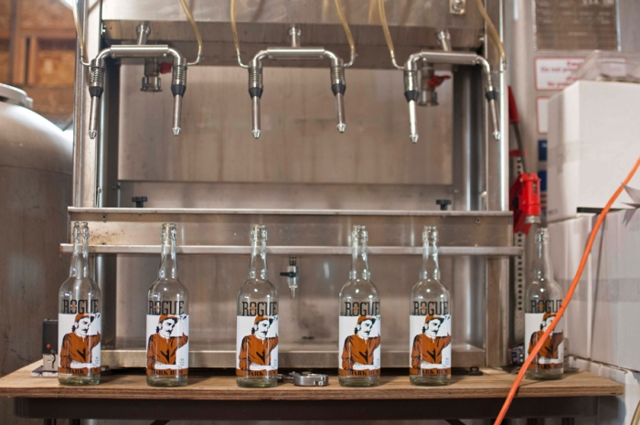 We bottle all our spirits, six bottles at a time, by hand.