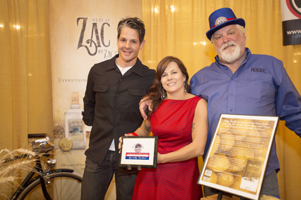 Rogue Nation President Big Al (right) presented the award to Skip Rock Distillery.