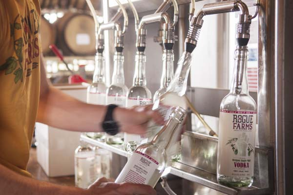 At Rogue Spirits we can bottle up to six bottles at a time. That's a 50% improvement over our four bottler system!
