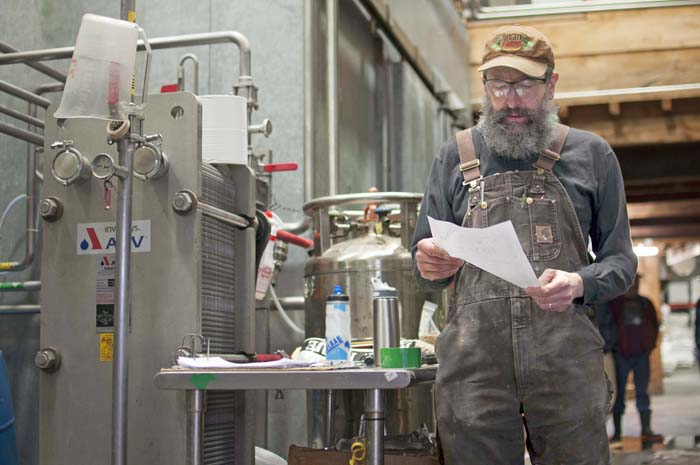 John Maier at work in the Brewery fine tuning a mash for Rogue Spirits.