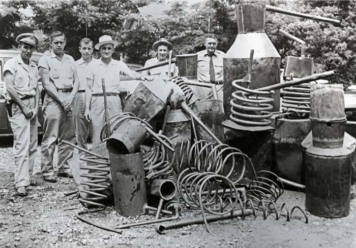 Busting a Tennessee moonshine still circa 1940.