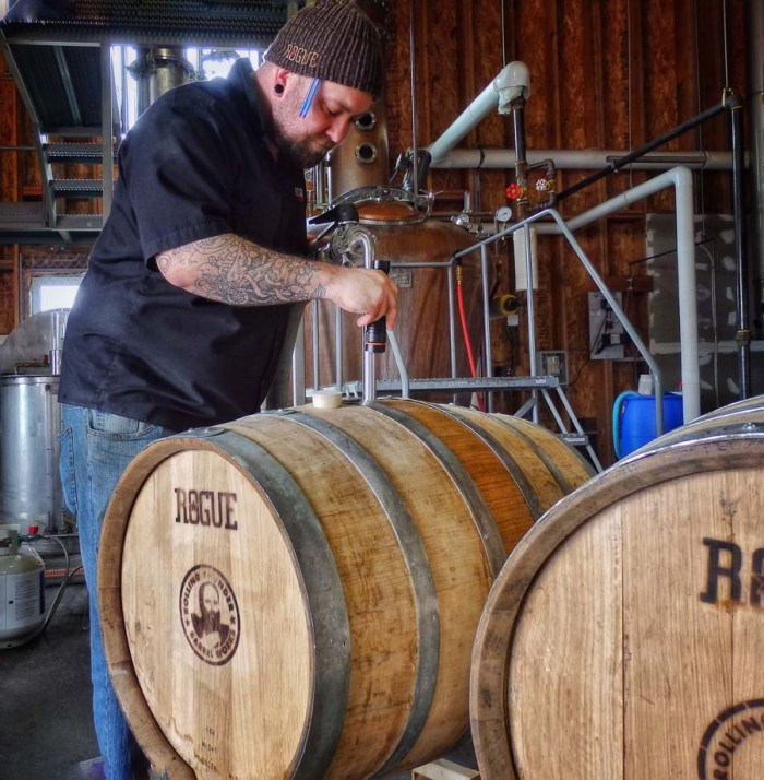 Filling a Rolling Thunder Barrel with Rogue Spirits' Dead Guy Whiskey.