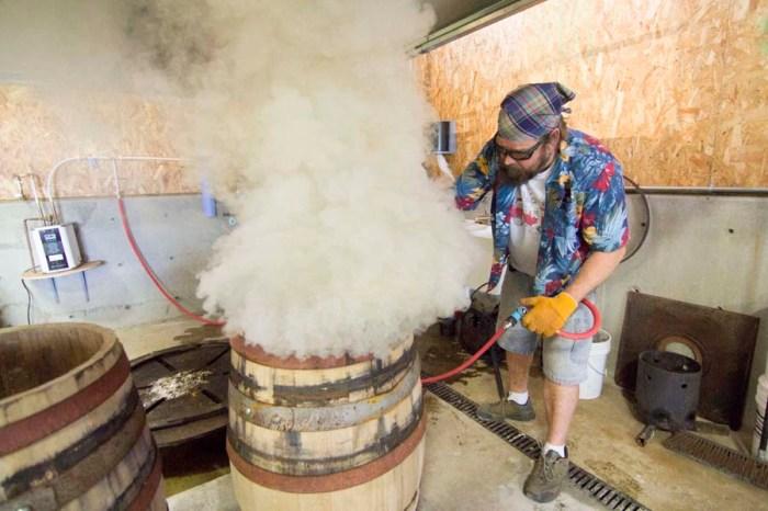 Nate charring barrels at Rolling Thunder Barrel Works.